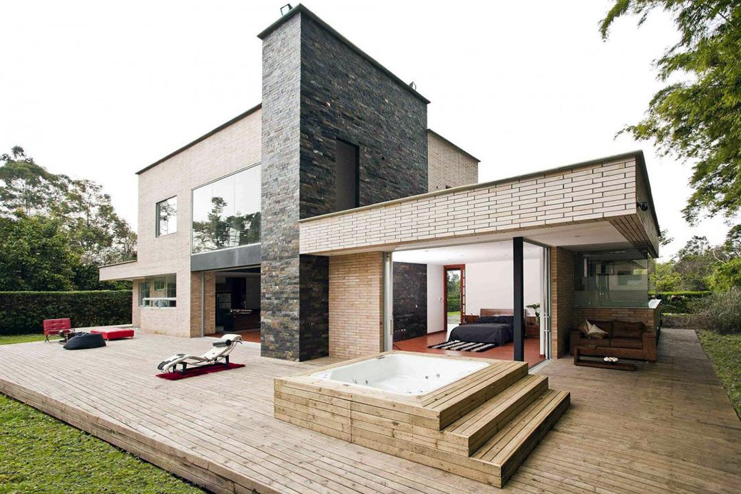 Отделка фасада дома декоративным камнем - фото 8