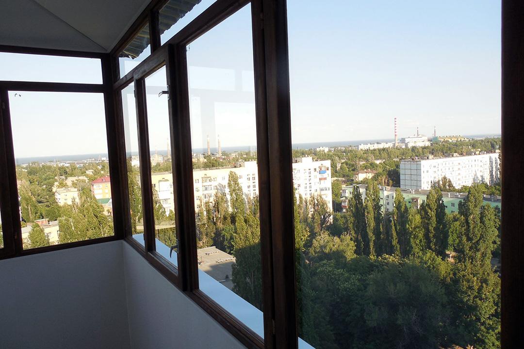 Тип остекления балкона: деревянные рамы